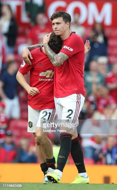 Victor Lindelof and Daniel James of Manchester United walk off after the Premier League match between Manchester United and Leicester City at Old...