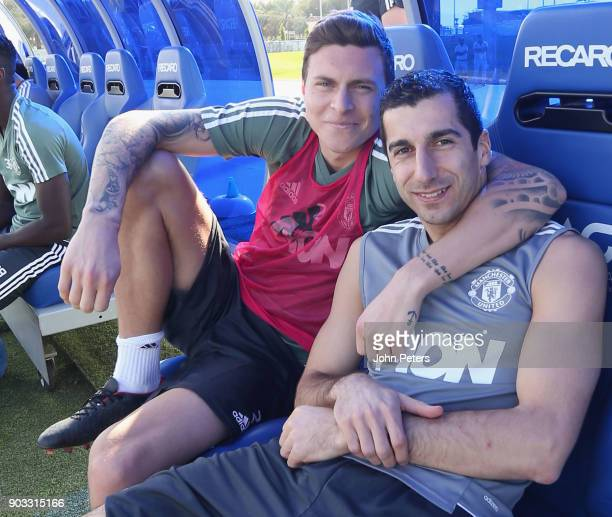 Victor Lindelof and Henrikh Mkhitaryan of Manchester United in action during a first team training session at Nad Al Sheba Sports Complex on January...