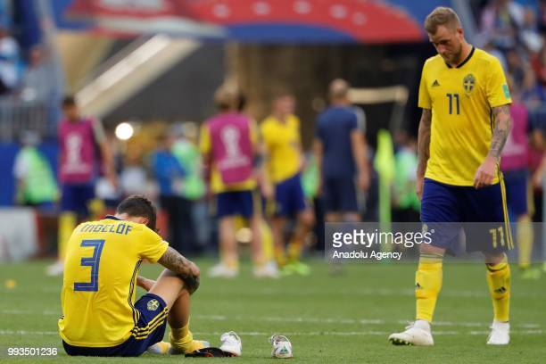 Victor Lindelof and John Guidetti of Sweden are upset after losing against England on the 2018 FIFA World Cup Russia quarter final match between...