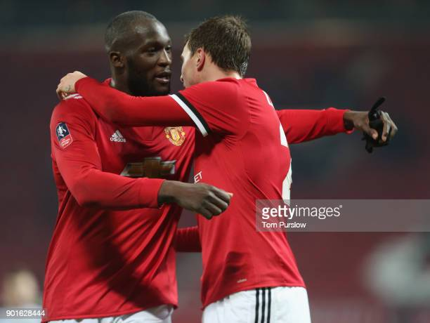 Victor Lindelof and Romelu Lukaku of Manchester United celebrate after the Emirates FA Cup Third Round match between Manchester United and Derby...