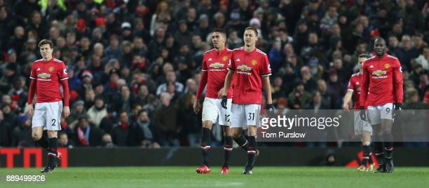 Victor Lindelof Chris Smalling Nemanja Matic and Romelu Lukaku of Manchester United show their disappointment at conceding a goal to Nicolas Otamendi...