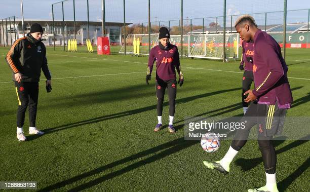 Victor Lindelof, Jesse Lingard, Paul Pogba of Manchester United in action during a first team training session ahead of the UEFA Champions League...