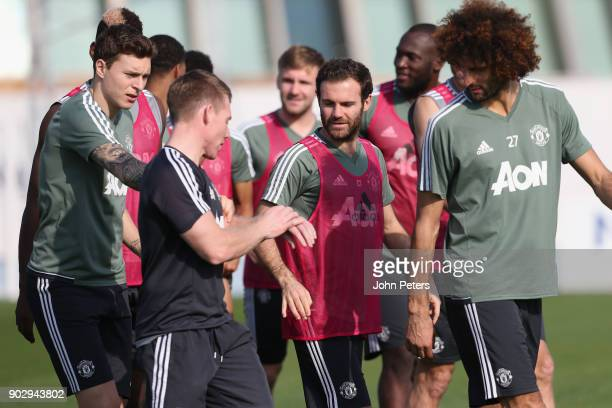 Victor Lindelof Juan Mata and Marouane Fellaini of Manchester United in action during a first team training session at Nad Sheba Sports Complex on...