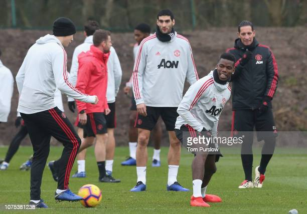 Victor Lindelof Marouane Fellaini and Paul Pogba of Manchester United in action during a first team training session at Aon Training Complex on...