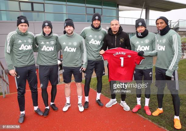 Victor Lindelof Matteo Darmian Luke Shaw Chris Smalling Jesse Lingard and Ashley Young of Manchester United pose with boxer Chris Eubank Jnr at Aon...