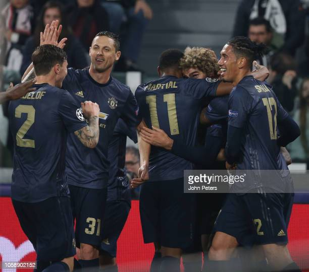 Victor Lindelof, Nemanja Matic, Anthony Martial, Marouane Fellaini and Chris Smalling of Manchester United celebrate after the Group H match of the...