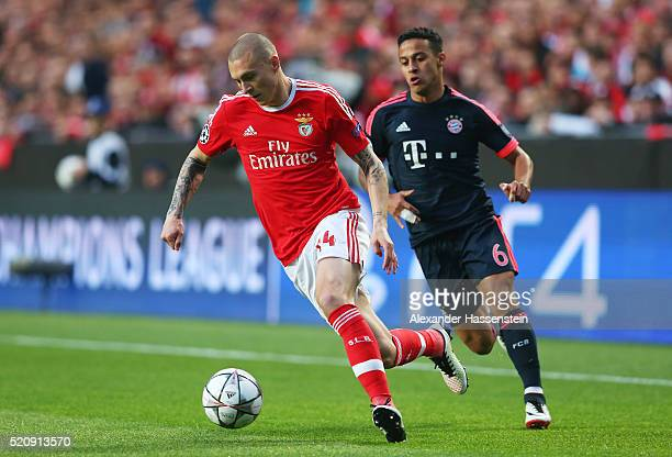 Victor Lindelof of Benfica is closed down by Thiago Alcantara of Bayern Muenchen during the UEFA Champions League quarter final second leg match...