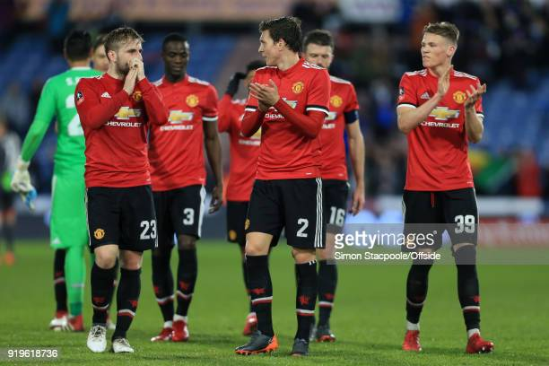 Victor Lindelof of Man Utd walks alongside teammates Luke Shaw of Man Utd and Scott McTominay of Man Utd after The Emirates FA Cup Fifth Round match...
