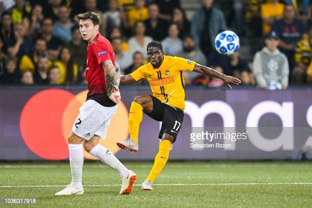 Victor Lindelof of Manchester and Roger Assale of Bern during the Champions League match between Young Boys Berne and Manchester United at Stade de...