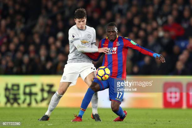 Victor Lindelof of Manchester United and Christian Benteke of Crystal Palace in action during the Premier League match between Crystal Palace and...