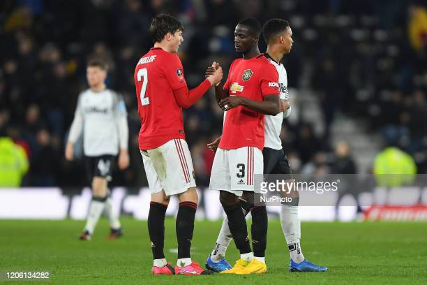 Victor Lindelof of Manchester United and Eric Bailly of Manchester United celebrate victory during the FA Cup match between Derby County and...