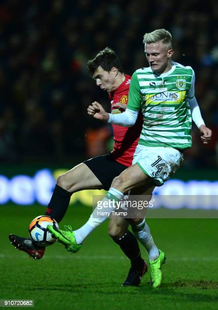 Victor Lindelof of Manchester United and Sam Surridge of Yeovil Town during The Emirates FA Cup Fourth Round match between Yeovil Town and Manchester...