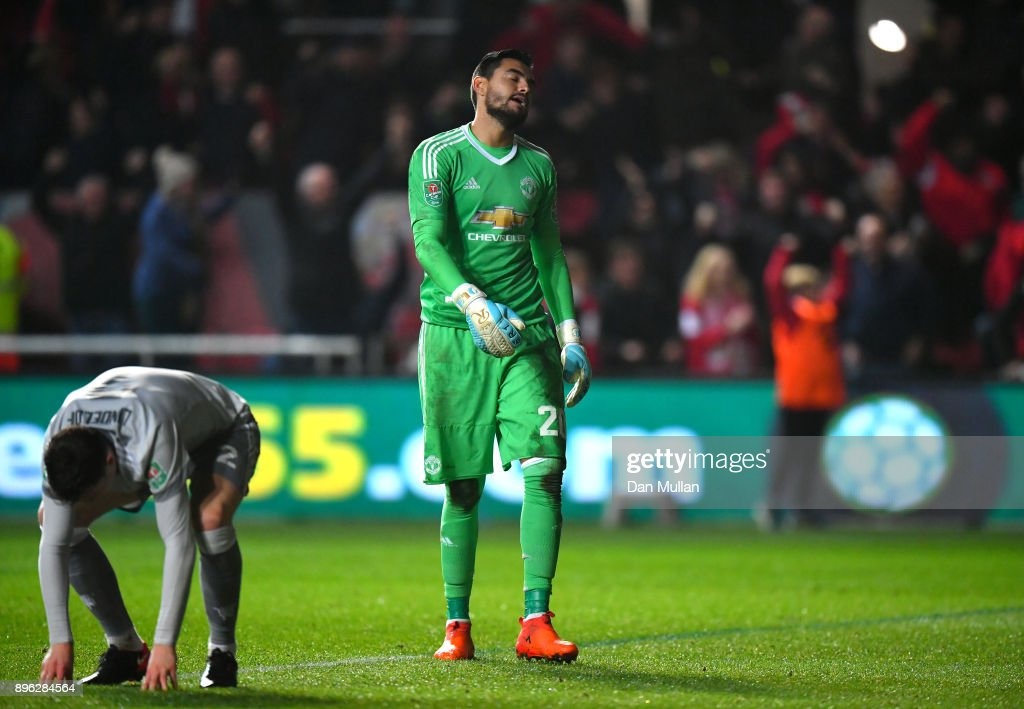 Victor Lindelof of Manchester United and teammate Sergio Romero look dejected after conceding during the Carabao Cup Quarter-Final match between Bristol City and Manchester United at Ashton Gate on December 20, 2017 in Bristol, England.