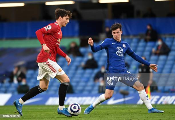 Victor Lindelof of Manchester United battles for possession with Mason Mount of Chelsea during the Premier League match between Chelsea and...