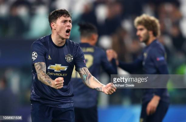 Victor Lindelof of Manchester United celebrates at the full time whistle after the UEFA Champions League Group H match between Juventus and...