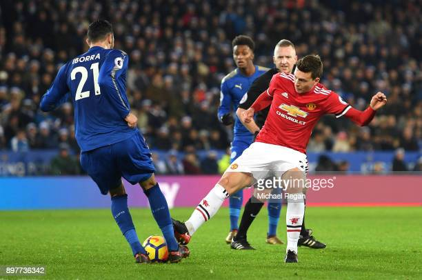 Victor Lindelof of Manchester United fouls Vicente Iborra of Leicester City leading to a yellow card during the Premier League match between...