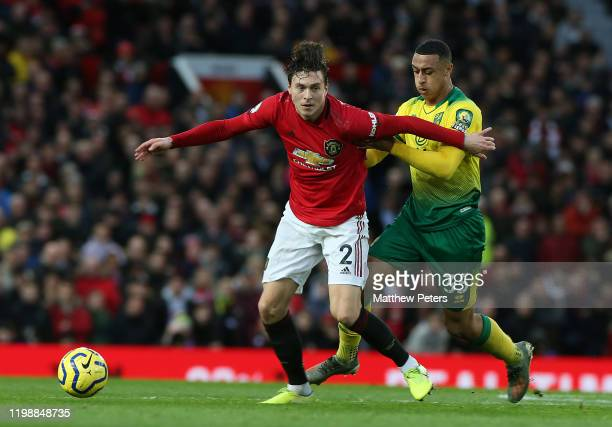 Victor Lindelof of Manchester United in action with Adam Idah of Norwich City during the Premier League match between Manchester United and Norwich...