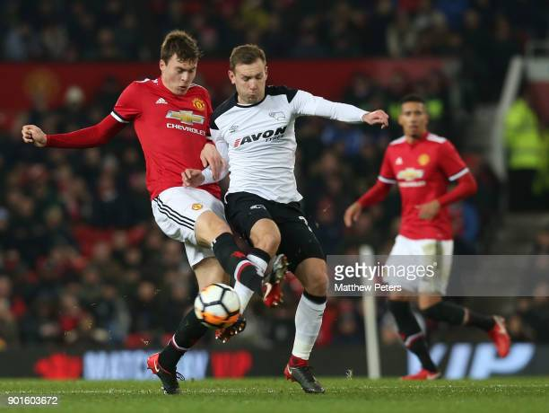 Victor Lindelof of Manchester United in action with Andreas Weimann of Derby County during the Emirates FA Cup Third Round match between Manchester...