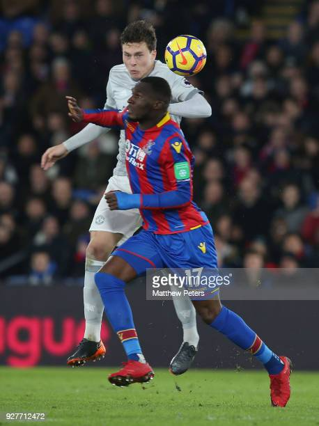 Victor Lindelof of Manchester United in action with Christian Benteke of Crystal Palace during the Premier League match between Crystal Palace and...