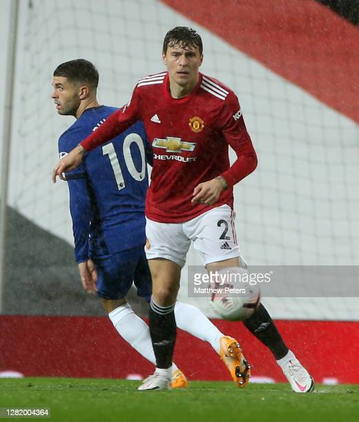 Victor Lindelof of Manchester United in action with Christian Pulisic of Chelsea during the Premier League match between Manchester United and...