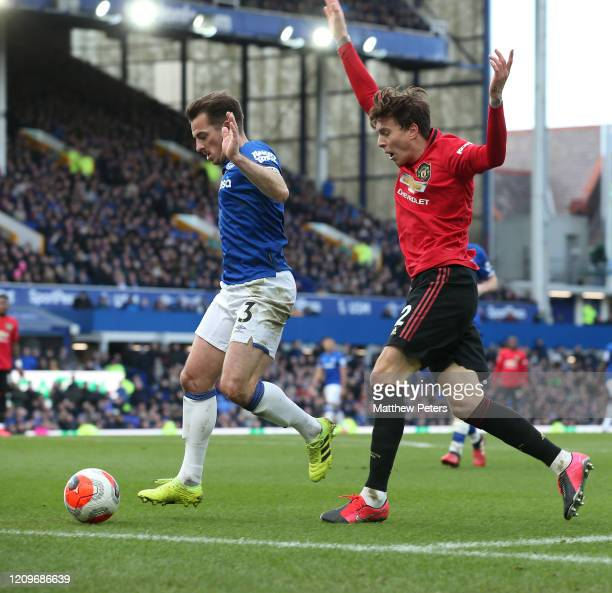 Victor Lindelof of Manchester United in action with Leighton Baines of Everton during the Premier League match between Everton FC and Manchester...