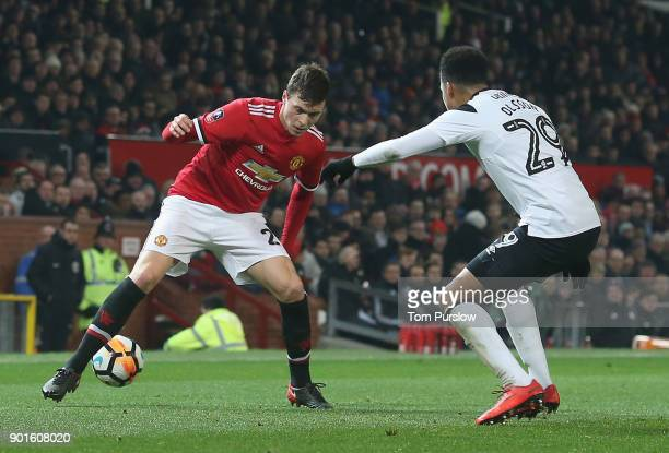 Victor Lindelof of Manchester United in action with Marcus Olsson of Derby County during the Emirates FA Cup Third Round match between Manchester...