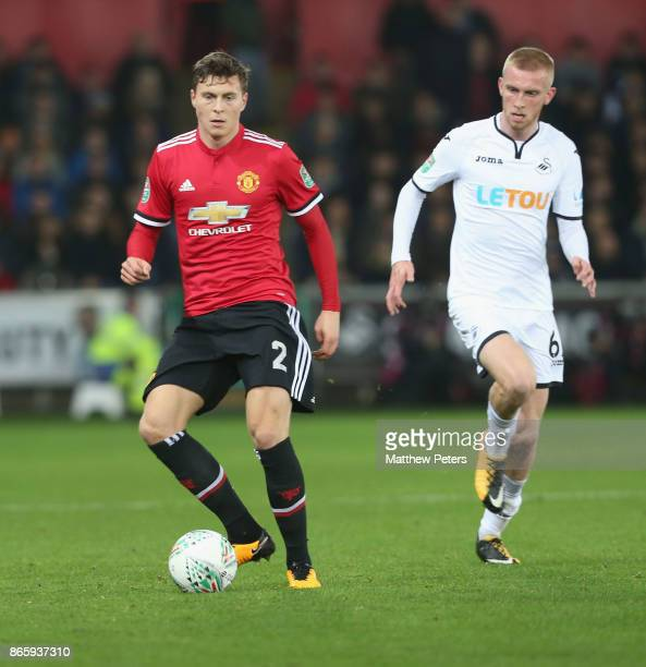 Victor Lindelof of Manchester United in action with Oli McBurnie of Swansea City during the Carabao Cup Fourth Round match between Swansea City and...
