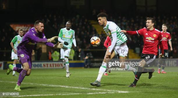 Victor Lindelof of Manchester United in action with Omar Sowunmi of Yeovil Town during the Emirates FA Cup Fourth Round match between Yeovil Town and...