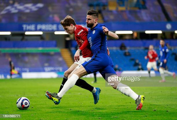 Victor Lindelof of Manchester United is challenged by Olivier Giroud of Chelsea during the Premier League match between Chelsea and Manchester United...
