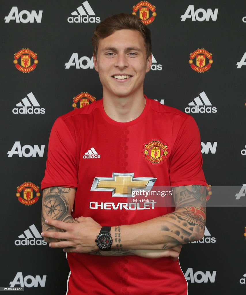 Victor Lindelof of Manchester United poses after signing for the club at Aon Training Complex on June 14, 2017 in Manchester, England.