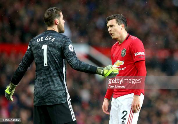 Victor Lindelof of Manchester United reacts with teammate David De Gea after scoring an own goal during the Premier League match between Manchester...