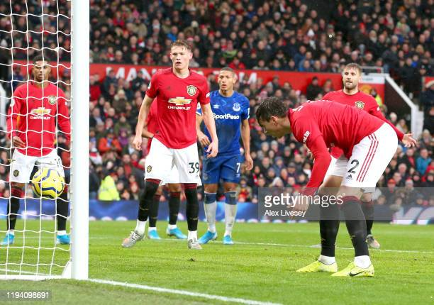 Victor Lindelof of Manchester United scores an own goal for Everton's first goal during the Premier League match between Manchester United and...