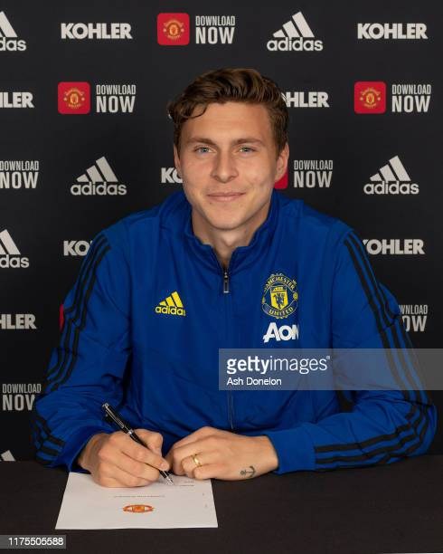 Victor Lindelof of Manchester United signs a contract extension at the club at Aon Training Complex on September 18 2019 in Manchester England