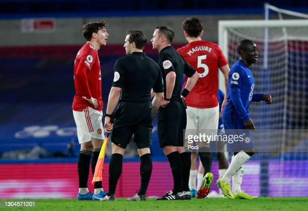 Victor Lindelof of Manchester United speaks with Match Referee, Stuart Attwell following the Premier League match between Chelsea and Manchester...