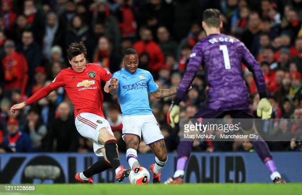 Victor Lindelof of Manchester United tackles Raheem Sterling of Manchester City during the Premier League match between Manchester United and...