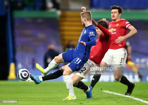 Victor Lindelof of Manchester United tackles Timo Werner of Chelsea during the Premier League match between Chelsea and Manchester United at Stamford...