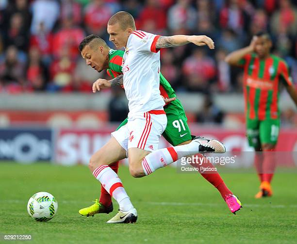 Victor Lindelof of SL Benfica challenges Patrick of CS Maritimo during the Portuguese Primeira Liga at Estadio dos Barreiros on May 8 2016 in Funchal...