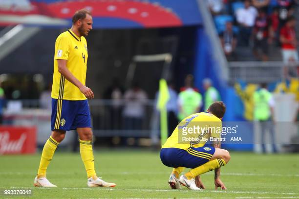 Victor Lindelof of Sweden and Andreas Granqvist of Sweden look dejected during the 2018 FIFA World Cup Russia Quarter Final match between Sweden and...