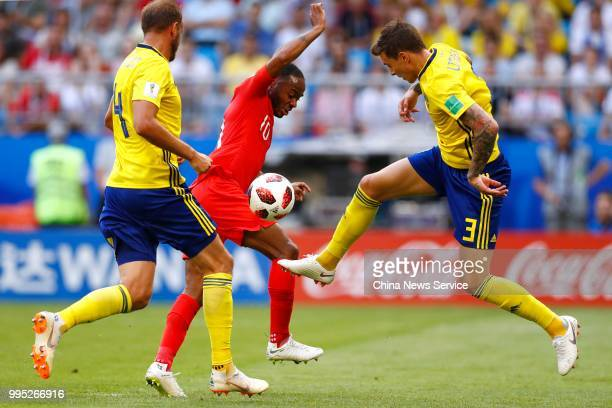 Victor Lindelof of Sweden and Raheem Sterling of England compete during the 2018 FIFA World Cup Russia Quarter Final match between Sweden and England...