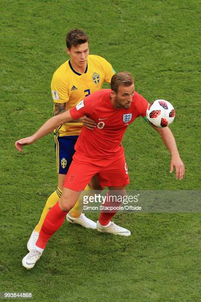 Victor Lindelof of Sweden battles with Harry Kane of England during the 2018 FIFA World Cup Russia Quarter Final match between Sweden and England at...