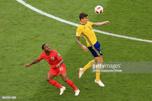 Victor Lindelof of Sweden gets to a header before Raheem Sterling of England during the 2018 FIFA World Cup Russia Quarter Final match between Sweden...