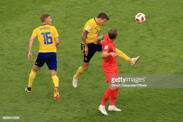 Victor Lindelof of Sweden heads clear from Harry Kane of England during the 2018 FIFA World Cup Russia Quarter Final match between Sweden and England...