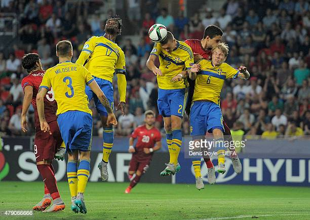 Victor Lindelof of Sweden heads the ball during the UEFA Under 21 European Championship 2015 Final between Sweden and Portugal at Eden Stadium on...