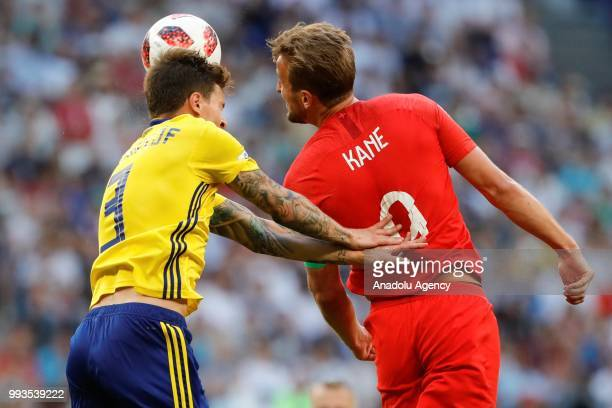 Victor Lindelof of Sweden in action against Harry Kane of England during the 2018 FIFA World Cup Russia quarter final match between Sweden and...
