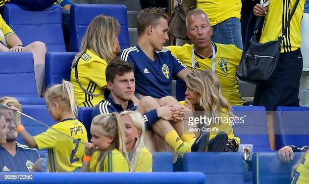 Victor Lindelof of Sweden is consoled by his wife Maja Nilsson above him Ludwig Augustinsson and girlfriend following the 2018 FIFA World Cup Russia...