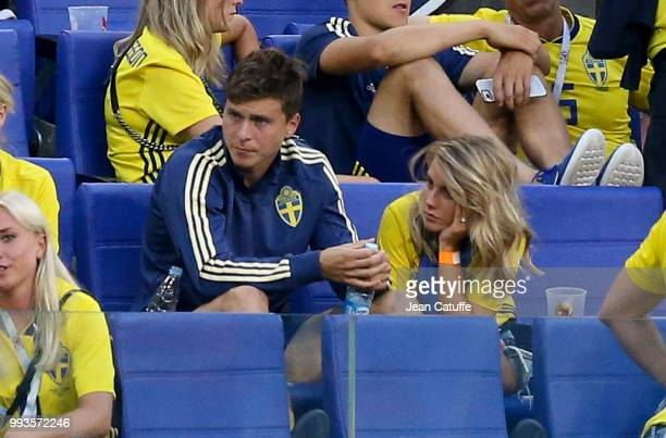 Victor Lindelof of Sweden is consoled by his wife Maja Nilsson following the 2018 FIFA World Cup Russia Quarter Final match between Sweden and...