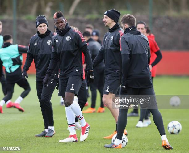 Victor Lindelof Paul Pogba Zlatan Ibrahimovic and Michael Carrick of Manchester United in action during a first team training session at Aon Training...
