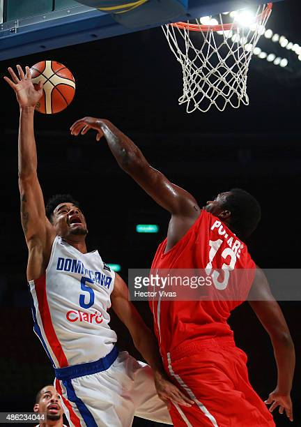 Victor Liz of Dominican Republic goes for a layup against Leonarde Pomare of Panama during a match between Dominican Republic and Panama as part of...
