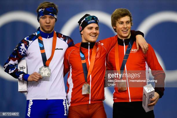 Victor Lobas of Russia Kristian Ulekleiv of Norway and Runar Njatun Kroyer of Norway stand on the podium after the men's neo senior 1500 meter final...
