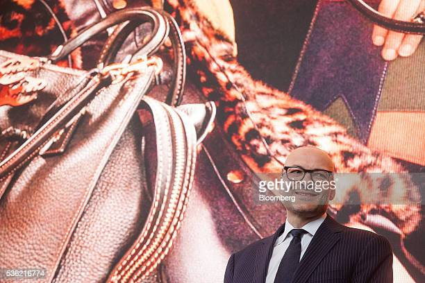 Victor Luis chief executive officer of Coach Inc smiles during the opening of Coach Inc's new offices at 10 Hudson Yards in New York US on Tuesday...